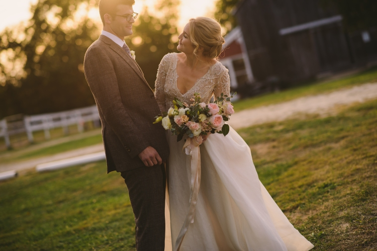 Bride and groom looking into each others eyes at sunset on wedding day