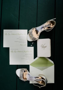 Brides accessories shoes and wedding invitations on a flat lay
