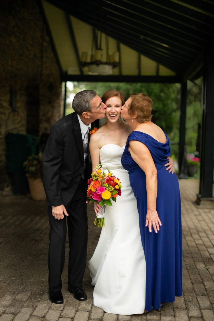 Bride with parents on wedding day in Pennsylvania